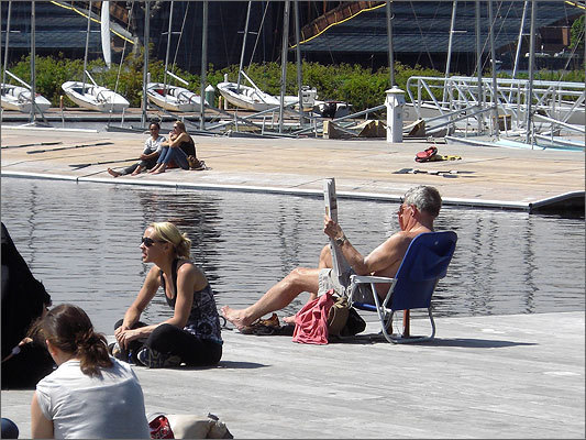 People soaked up the sun on the Esplanade's docks.