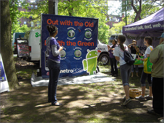 In keeping with the environmentally friendly theme, MetroPCS hosted a game that required tossing old cell phones.