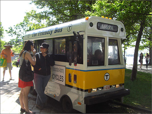 Kids check out a miniature MBTA bus.