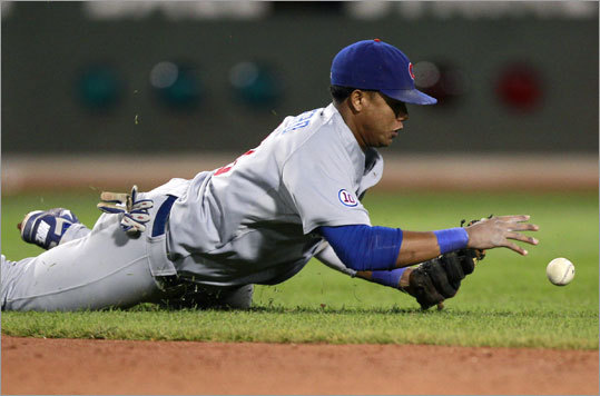 Cubs shortstop Starlin Castro stopped Adrian Gonzalez's seventh-inning single from reaching the outfield, but Gonzalez reached safely to set the table for Youkilis's two-run triple.