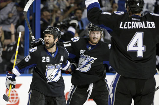 After scoring to tie the score 2-2 in the second period, the Lightning's Martin St. Louis (left) celebrated with teammates Steven Stamkos and Vincent Lecavalier.