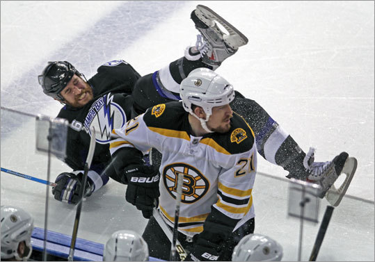 Tampa Bay's Ryan Malone was left sprawling on the ice after sailing over the back of the Bruins' Andrew Ference in front of the Boston bench in the first period.