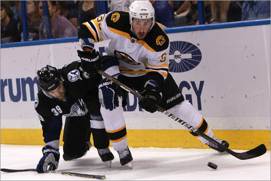 Bruins left wing Brad Marchand won possession of the puck over Lightning defenseman Mike Lundin in the first period.