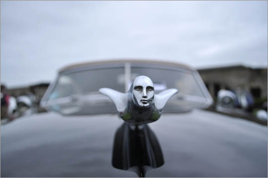The soaring hood ornament on the Cadillac, along with many models of this era, spare no expense to detail.