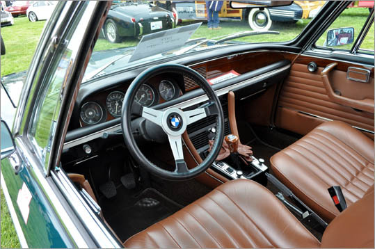 The natural-finish leather and bright woodwork on this 1972 BMW 3.0CS coupe stood out among the more modern classics.