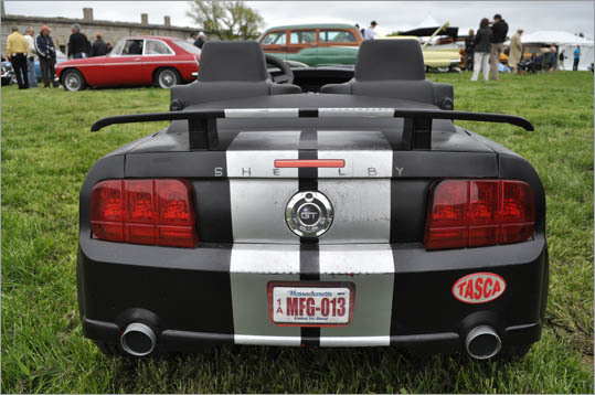 Kids took this 2007 Shelby Mustang for a spin (it's next to a matching, bigger Shelby equipped to race).