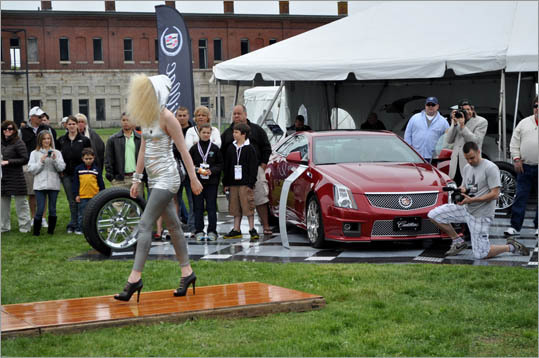 Models graced the stage in front of the Cadillac display.