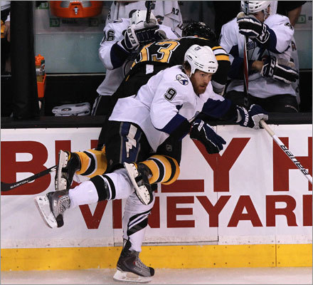 Bruins defenseman Zdeno Chara (left) took a heavy hit into the boards from Tampa Bay Lightning right wing Steve Downie.
