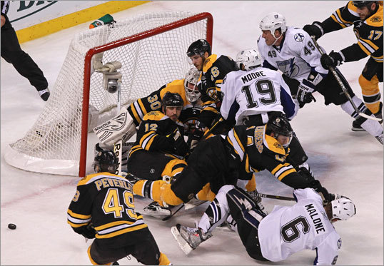 There was quite a crowd in front of Bruins goaltender Tim Thomas in the first period as the puck squirted free and away from danger.