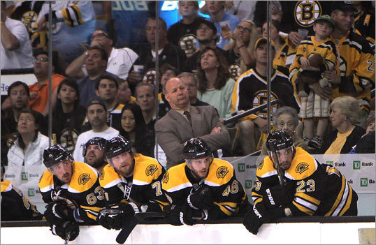 Bruins players, along with coach Claude Julien, watched action in front of the Tampa net with seconds left in the first.