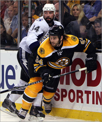 Adam McQuaid and Tampa's Nate Thompson chased after a loose puck behind Boston net.