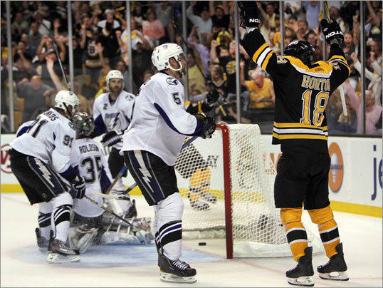 May 27, 2011: Bruins 1, Lightning 0 Bruins right winger Nathan Horton (right) scored with 7:33 left in the third period as the Bruins defeated Tampa Bay, 1-0, in Game 7 of the Eastern Conference finals at TD Garden. The goal sent the Bruins into the Stanley Cup Final for the first time in 21 years. Bruins goalie Tim Thomas stopped 24 shots for his second shutout of the series.