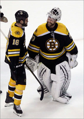 Tim Thomas (right) celebrated with goal-scorer Nathan Horton after the game. Thomas stopped 24 shots for his second shutout of the series.