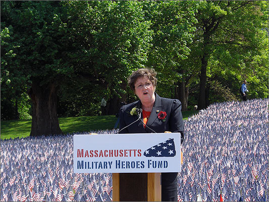 Alma Hart spoke about her son, Pfc. John D. Hart, who died in Iraq in 2003. She wore a brooch with a poppy -- 'a hearty, self-sowing wildflower' to represent the love and loss of 'the common soldier.'