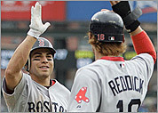 Josh Reddick, recalled from Triple-A Pawtucket before the game, greeted Jacoby Ellsbury after his home run.