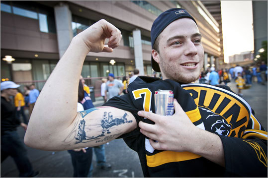 Craig Chiasson of Hudson showed off his Bobby Orr tattoo outside TD Garden.