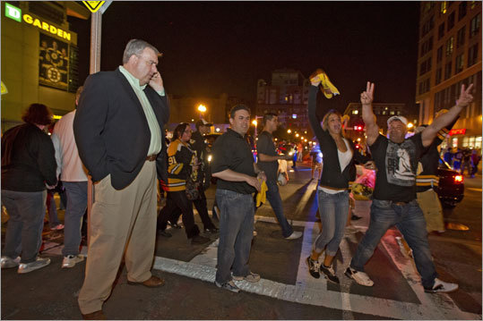 Boston Police Commissioner Ed Davis spoke on the phone on Causeway Street as Bruins fans exited TD Garden.