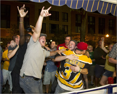 Bruins fans in front of Sports Grille Boston cheered when the game was over.