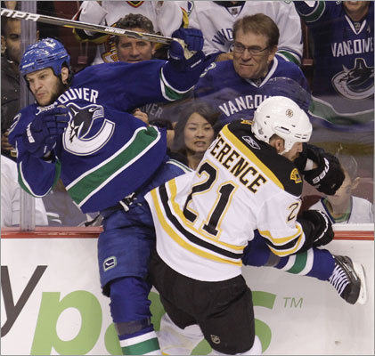 Bruins defenseman Andrew Ference and Canucks defenseman Kevin Bieksa collided in the first period.