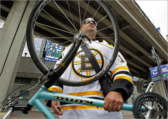 A real 'spoked-B' ... Steven Sicoli wore a Milan Lucic Bruins jersey as he got ready to ride a bicycle outside of the Rogers Arena.