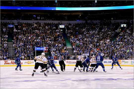 Game 1 of the Stanley Cup finals got underway when Boston's Patrice Bergeron faced off against Henrik Sedin of the Vancouver Canucks at Rogers Arena in Vancouver.