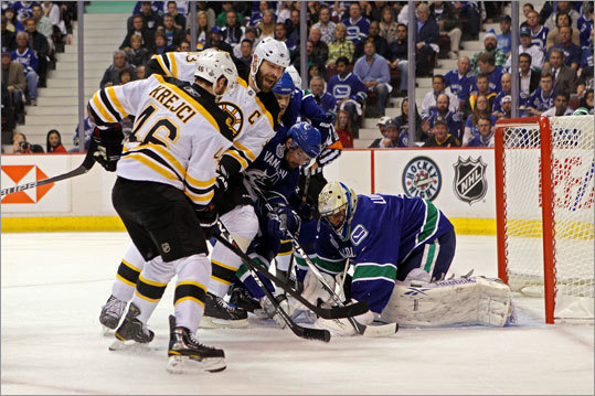 Vancouver's Roberto Luongo kept Bruins Zdeno Chara and David Krejci from scoring in the first period.
