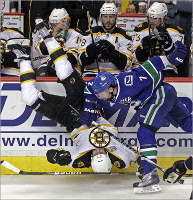 Vancouver's Dan Hamhuis flipped Bruins left wing Milan Lucic on his head in the second period of Game 1 of the Stanley Cup finals at Rogers Arena in Vancouver.
