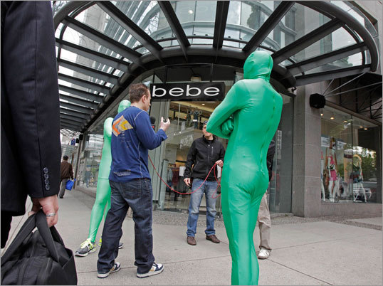 The 'Green Men', who are known for harassing opposing players in the penalty box at Rogers Arena, were doing a television interview on a downtown Vancouver, British Columbia street this morning. The Bruins will face the Vancouver Canucks in Game 1 of the Stanley Cup Finals tonight.
