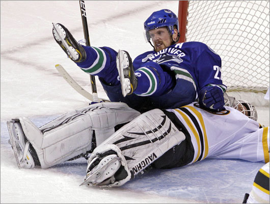 Canucks forward Daniel Sedin ended up on top of Bruins goalie Tim Thomas after a second-period collision.