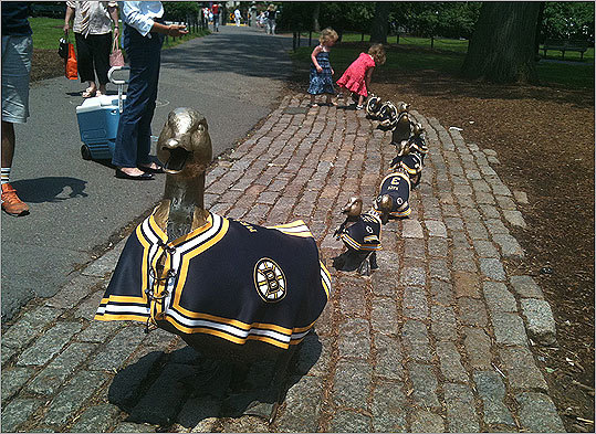 At left, all of Boston's famous ducklings boast their Bruins pride.