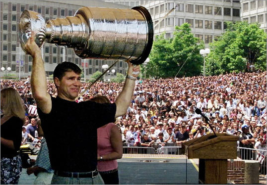 Bourque brings cup to Boston Ray Bourque played 21 seasons in Boston without winning a Stanley Cup, so when he won the Cup with Colorado in the twilight of his career, he chose to do something very unorthodox on his day with the trophy: he brought the trophy back to Boston. With the Bruins in the midst of a (right now) 39-year championship drought, more than 10,000 people came to see Bourque and the trophy in City Hall Plaza after the Avalanche won it all in 2001.
