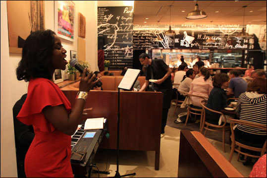 On a Sunday in May, Roz Beauty sings gospel at the Red Rooster on Lenox Avenue. Read: Harlem makes a visitor feel its forward movement