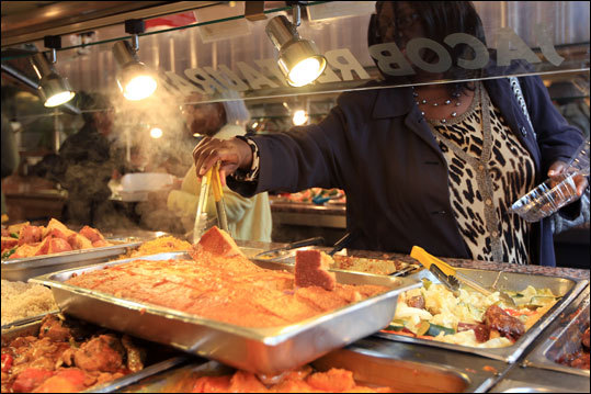 Crowds stob by famous Harlem's Jacob Restaurant after Sunday services. Read: Harlem makes a visitor feel its forward movement