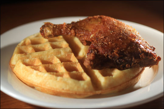 Fried chicken and waffles a staple of Amy Ruth's in Harlem. Read: Harlem makes a visitor feel its forward movement