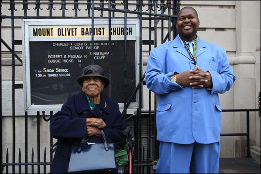 At Mt. Olive Baptist Church Anthony Nelson accompanies Wilhelmenia Smith, of Queens as she waits for a ride after Sunday service. Read: Harlem makes a visitor feel its forward movement