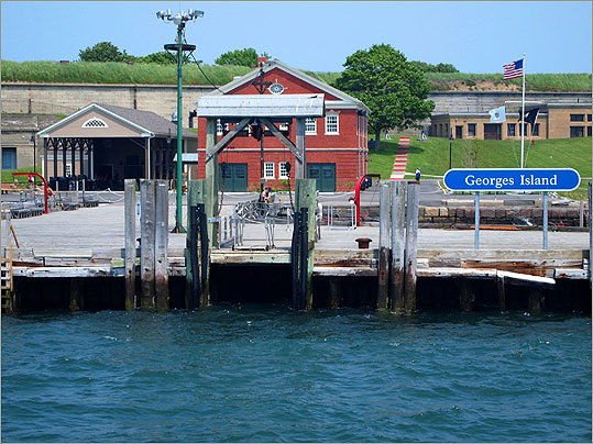 Two islands are accessible by ferry from Long Wharf, just across Atlantic Avenue from the new pavilion. The 39-acre Georges Island is the site of Fort Warren, built to defend Boston Harbor and used as a military training camp and as a Civil War prison. The red brick visitors' center seen here was built in 1906 and used for storage of mines that were put in the harbor for defense. The lower, open structure to the left holds a Jasper White's Summer Shack.