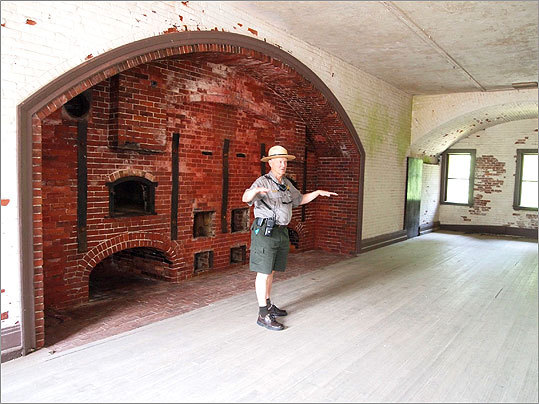 National Park Service Ranger Donald Cann stands before the giant oven in the fort's bakery area. The bakery was used until around 1900, when it was replaced by newer kitchens and mess halls. It was later used as an officers' club.