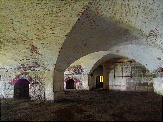 A view from inside Bastion A at the fort's eastern tip. Once an open courtyard, Bastion A was closed off after the Civil War to create space above for new gun emplacements. During World War II, this area was used as a recreation hall and movie house — the faint tracings of steps that once led to the projection booth are still visible along one wall.