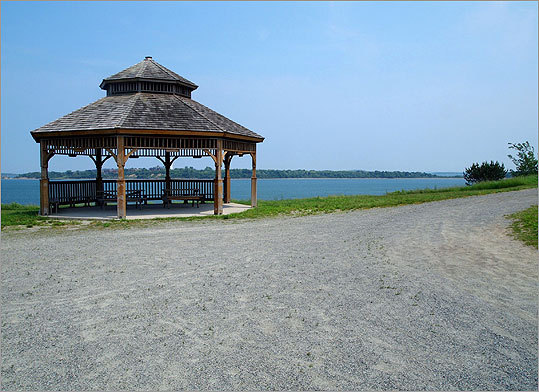 Though Spectacle Island has no mature trees and offers little natural shade, there are a few structures where visitors can get out of the sun, such as this gazebo overlooking Long Island.