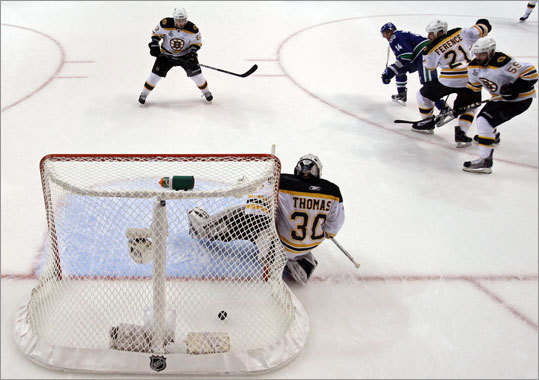 Alexandre Burrows lifted his shot over the left shoulder of Bruins goalie Tim Thomas for the goal that gave the Canucks a 1-0 lead. Many believed Burrows should have been suspended for Game 2 because it appeared he bit Bruins center Patrice Bergeron's finger in Game 1, but the NHL did not impose any penalty for the incident.