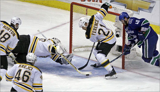 Bruins goalie Tim Thomas went to great lengths to stop Vancouver's Maxim Lapierre in the second period.