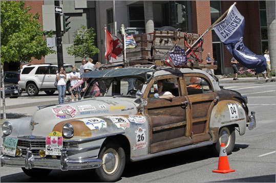 Some Canucks fans rolled past the Rogers Arena in an old car decorated with a Canucks flag, among other things.