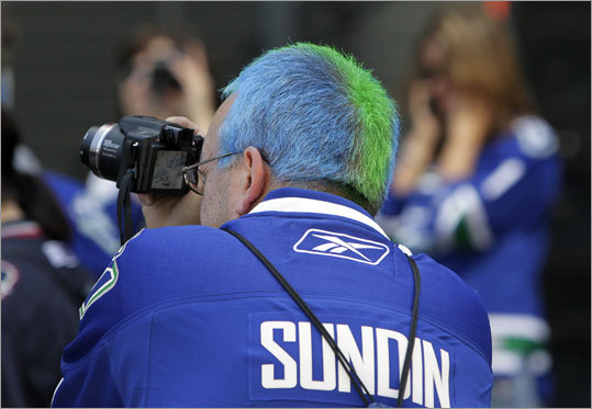 One Canucks fan dyed his hair in team colors for Game 2.