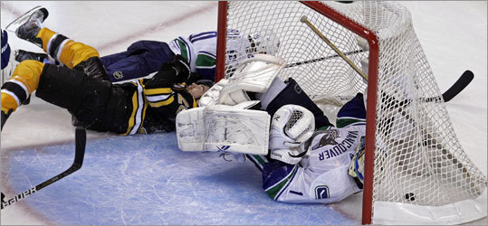 Bruins wing Daniel Paille collided with Canucks goalie Roberto Luongo after Paille scored in the third period.