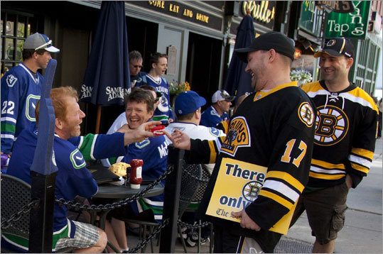 Canucks fans had a bit of fun at their own team's expense, using a set of fake teeth for a laugh with Bruins fans. The teeth were a reference to an incident in Game 1 of the Stanley Cup Final when Canucks forward Alex Burrows bit Bruins forward Patrice Bergeron on the finger, but was not suspended or fined by the NHL.