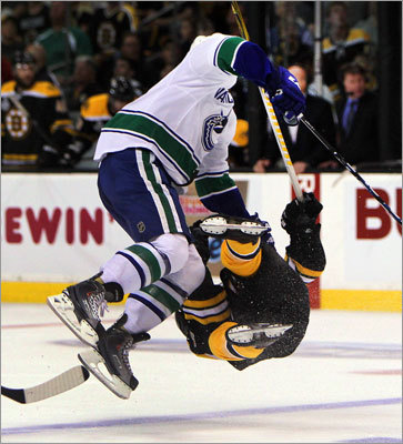 A scary scene developed five minutes into Game 3 of the Stanley Cup Final when Bruins right wing Nathan Horton was injured by a first-period hit from Vancouver's Aaron Rome. Horton was taken off the ice on a stretcher. Rome received a five-minute penalty for interference and was ejected from the game.