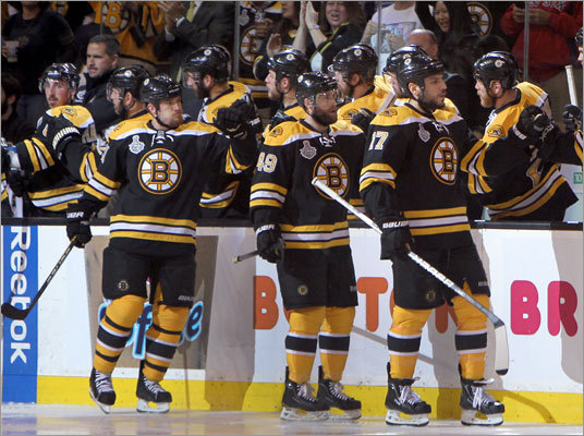 Bruins defenseman Andrew Ference (left) scored in the second period to give the Bruins a 1-0 lead. He was congratulated by players on the bench along with teammates along with Rich Peverley (center) and Milan Lucic.