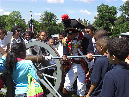 More than 1,000 students came out to the Boston Common on Monday for Making History on the Common Day, sponsored by the Friends of the Public Garden. Left: A demonstration of cannons that were once used at America's oldest public park. The Ancient and Honorable Artillery Company planned to fire the cannons at 2:30 p.m.