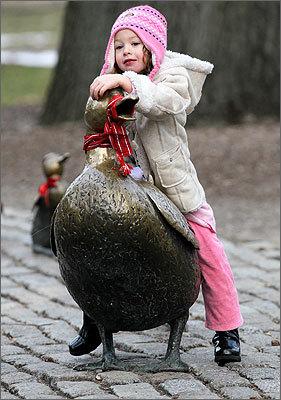 Jan. 8, 2011 Photo by Jonathan Wiggs of the Globe staff Dania Orabi, 4, from New Jersey sits atop Mrs. Mallard.