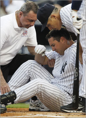 June 7: Red Sox 6, Yankees 4 Trainer Gene Monahan (left) checked on Yankees first baseman Mark Teixeira after he was hit in the right knee by a pitch from Red Sox starter Jon Lester. Teixeira left the game and was replaced by Jorge Posada. Teixeira suffered a contusion on the knee.